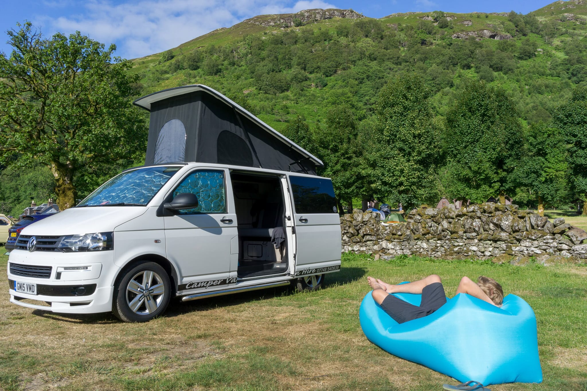 Relaxing on a camping site in a Camper Van