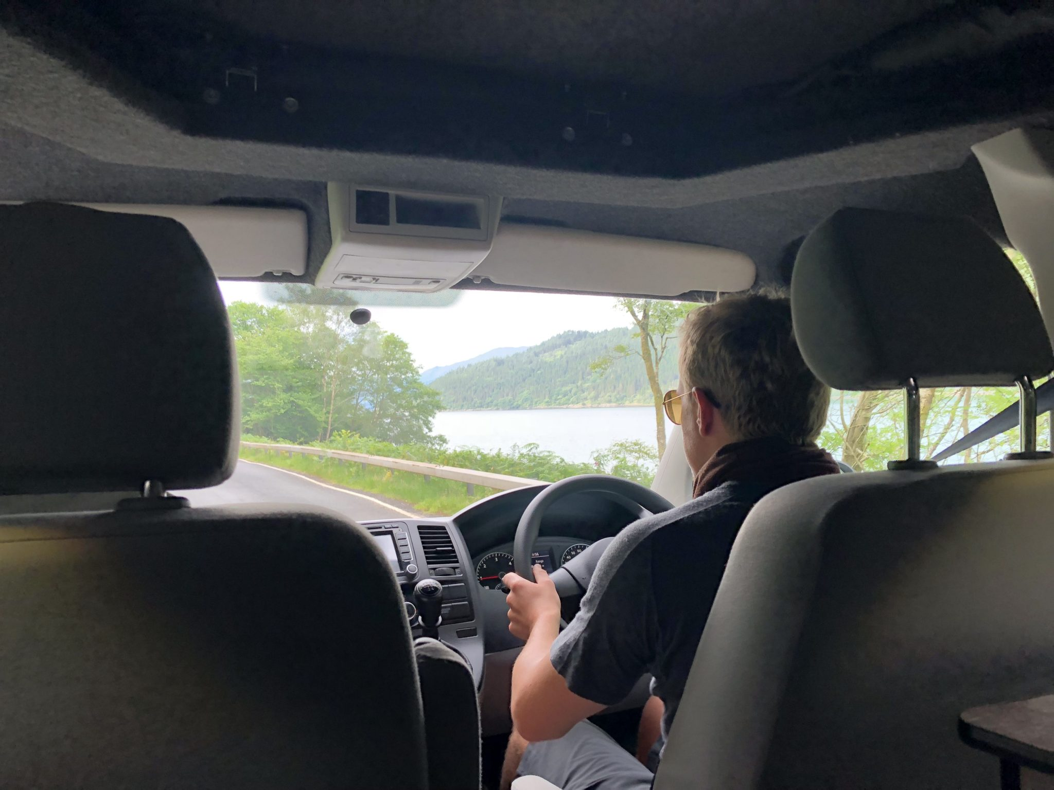 Driving down Scottish road in Campervan on a road trip